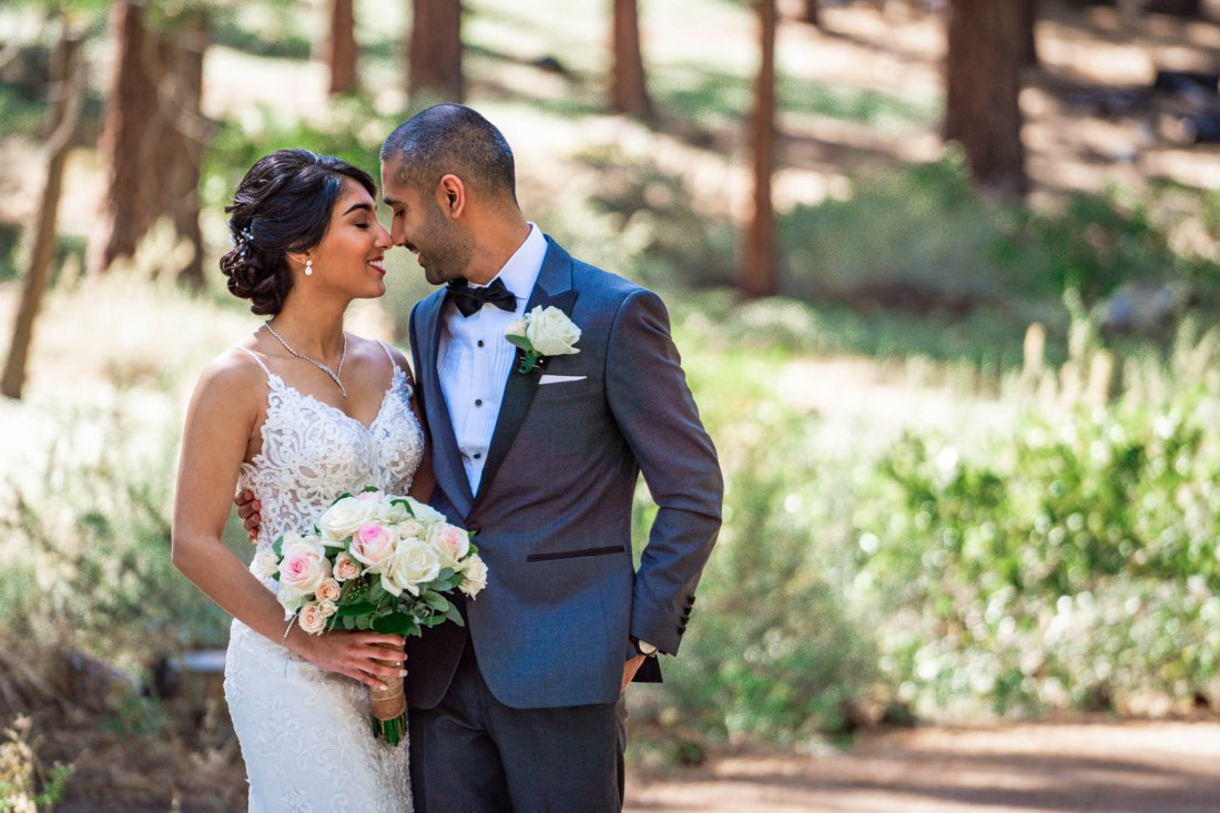 Bride and groom touch foreheads as they take their first look photos