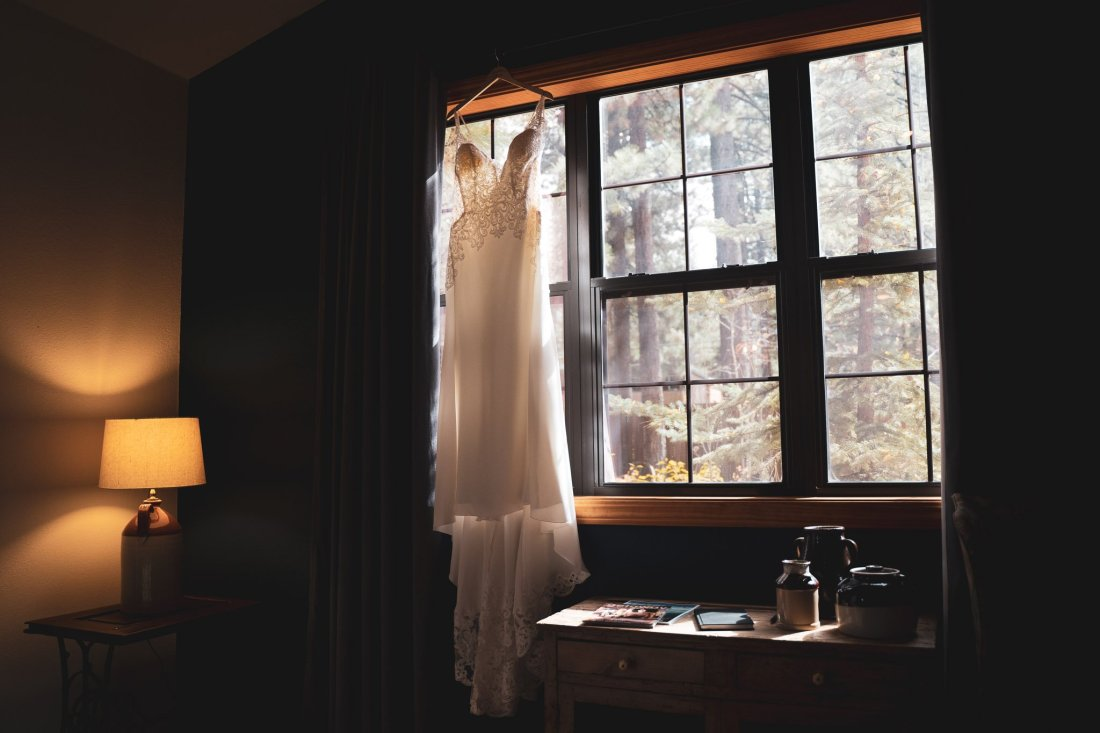 Wedding dress hanging from a window