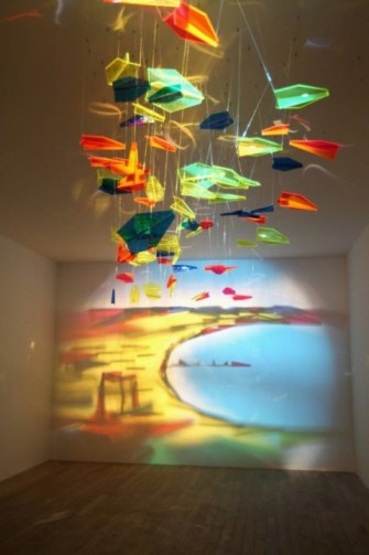 Light painting created by mobile of multicoloured perspex aeroplanes