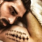 Akshay Dogra Tattoo on his bicep