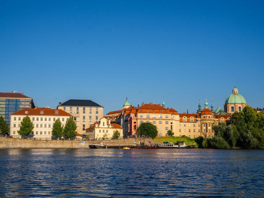 Red roofed buildings of Prague seen from river Vltava