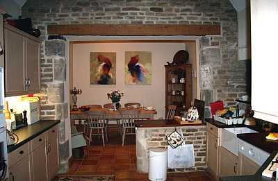 Kitchen area with paintings by David Kigozi, Pamela's home.