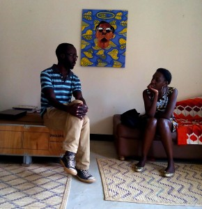 Ndema with curator Elise Atangana at his studio.
