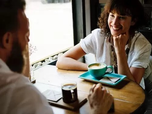 man and woman happily talking