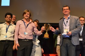 Pete Cooper awarding The Startup Trophy at SydStart 2014 to GoFar Cofounder Danny Adams