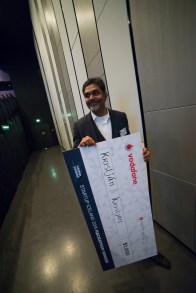 Bala Standing with the SI2015 Hackathon Winner Cheque