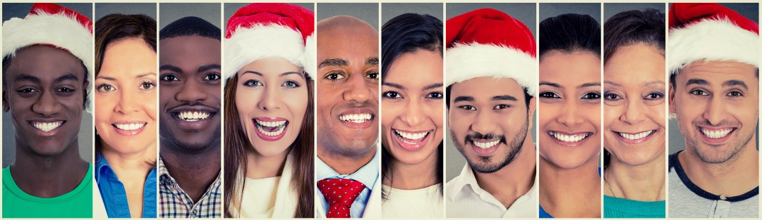 Smiling faces. Happy multi ethnic group of people some in Christmas Santa hat