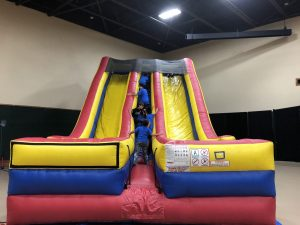 Dual giant indoor slide rental
