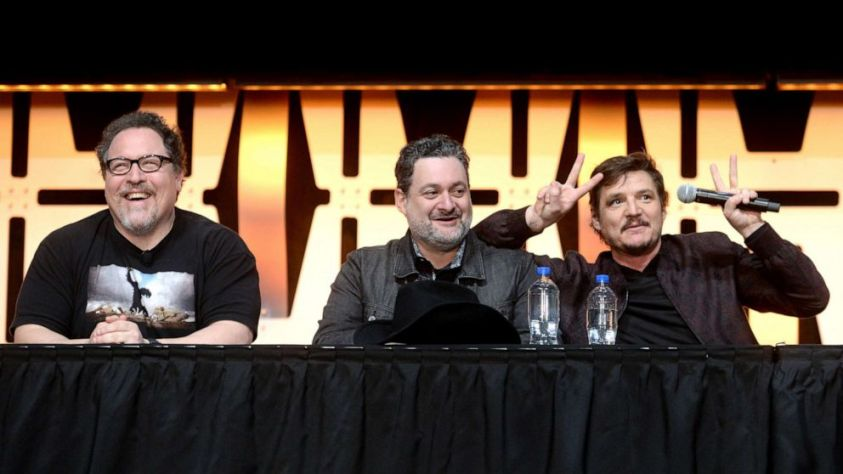 "Writer/executive producer Jon Favreau, Director/executive producer Dave Filoni and Pedro Pascal onstage during ""The Mandalorian"" panel at the Star Wars Celebration at McCormick Place Convention Center, April 14, 2019, in Chicago."