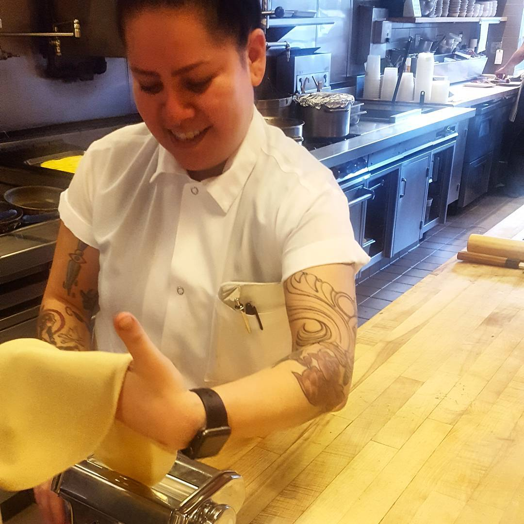 Elisa rolling out dough to fill with guinea hen farcehellip