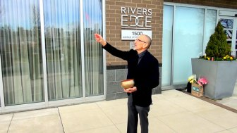 Feng Shui practitioner Alex Stark demonstrates a feng shui blessing at 1500 Avenue at Port Imperial, Weehawken, NJ.