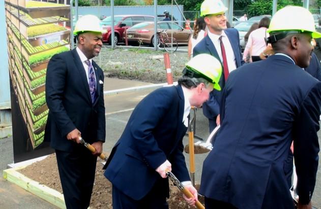 Newark Mayor Ras Baraka, left, takes part in the ceremonial shovel throw at groundbreaking for the AeroFarms vertical farm in the Ironbound section of Newark, NJ. (StateBroadcastNews.com/Steve Lubetkin Photo)