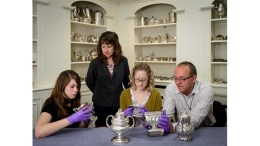 Senior Objects Conservator Bruno Pouliot (far right) and Curator of Decorative Arts Ann Wagner (standing) examine coatings on silver objects during Phase I (2013-15) of the IMLS-funded project, alongside former Conservation Technicians Maggie Bearden (left) and Kaitlin Andrews (right).