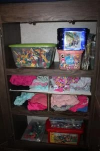 Kids closet with bins