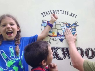 Our Adventurous daughter Journey getting excited about adding a sticker to our map