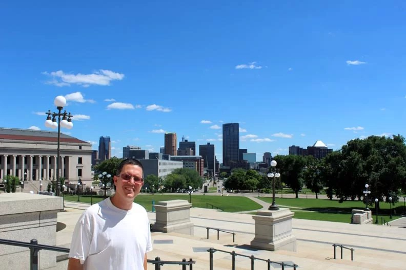 Chris with the city in the background.