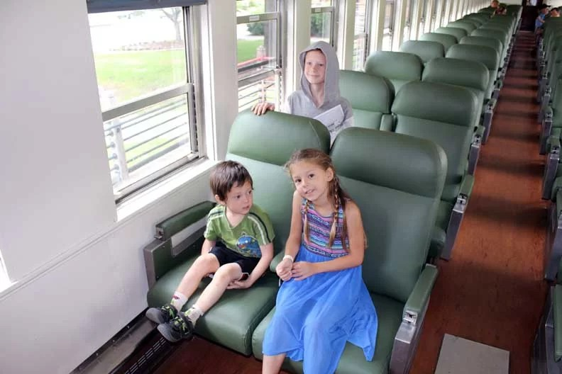 Kids sitting on a train.