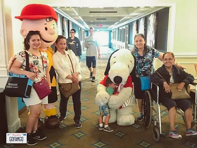 A multi-generational family with Snoopy