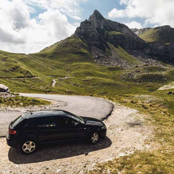 A vehicle parked near a mountain top.