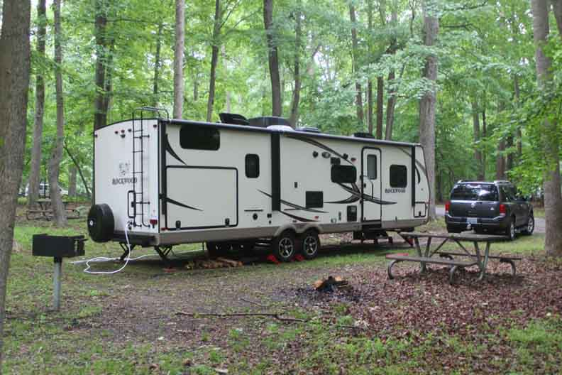 A travel trailer in a campsite.