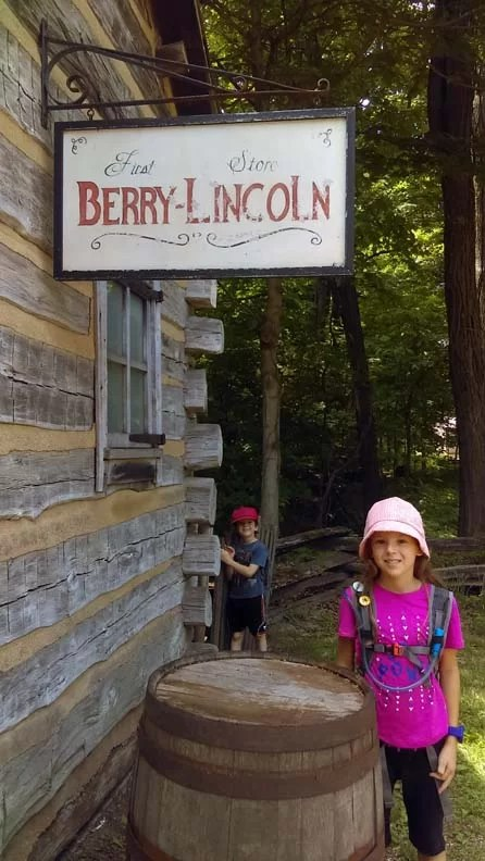 Two kids next to Lincoln's store in the land of Lincoln.