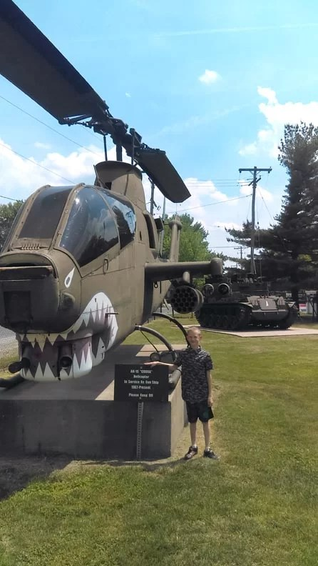 Miles next to a helicopter.