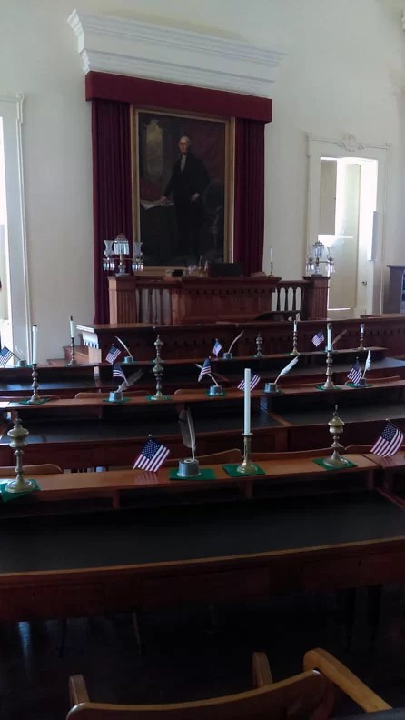 The house chambers with Washington overlooking the desks.
