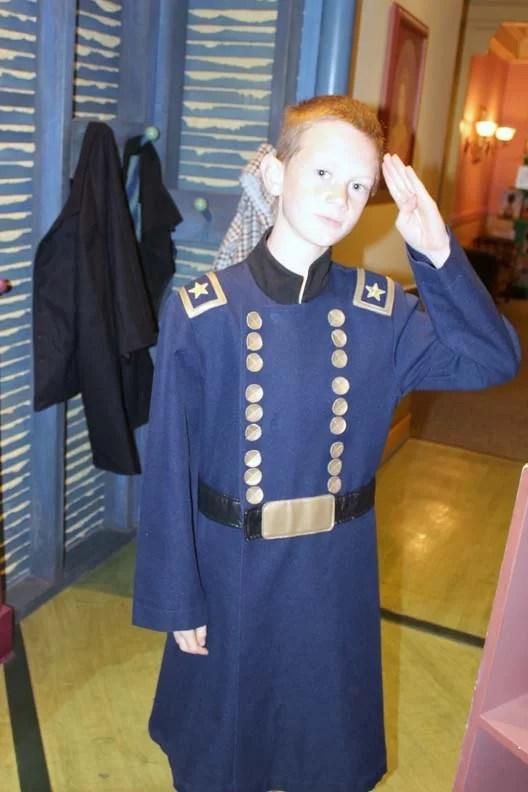 A kid saluting.