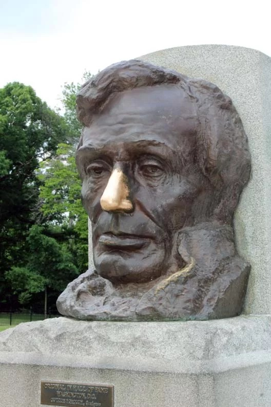 A statue of Lincoln's head with the nose rubbed clean.