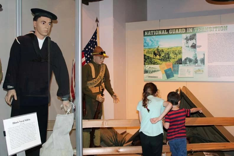 Two kids reading museum displays.