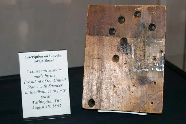 A board filled with bullet holes.