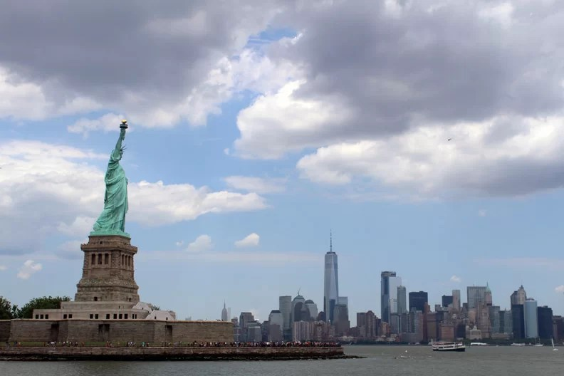 The Statue of Liberty overlooking the New York City Skyline