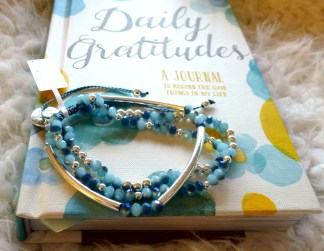 """Daily Gratitudes"" Journal for recording happy thoughts and a ""Mardi Gras"" bracelet from Boho Betty"