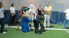Willy P and the Easter Bunny handing out gifts to kids.