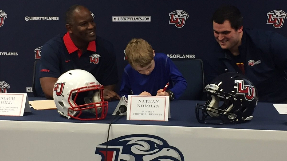 Liberty University football team signs 9-year-old boy with ...