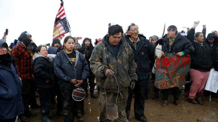 Nathan Phillips (C,right) prays with other protesters near the main opposition camp against the Dakota Access oil pipeline near Cannon Ball, North Dakota, US. (Image: Reuters)