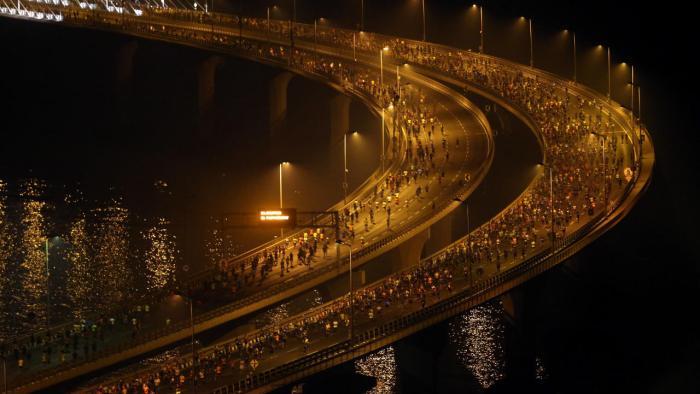 Participants run along the Bandra-Worli sea link over the Arabian Sea during Tata Mumbai Marathon, in Mumbai. (Image: Reuters)