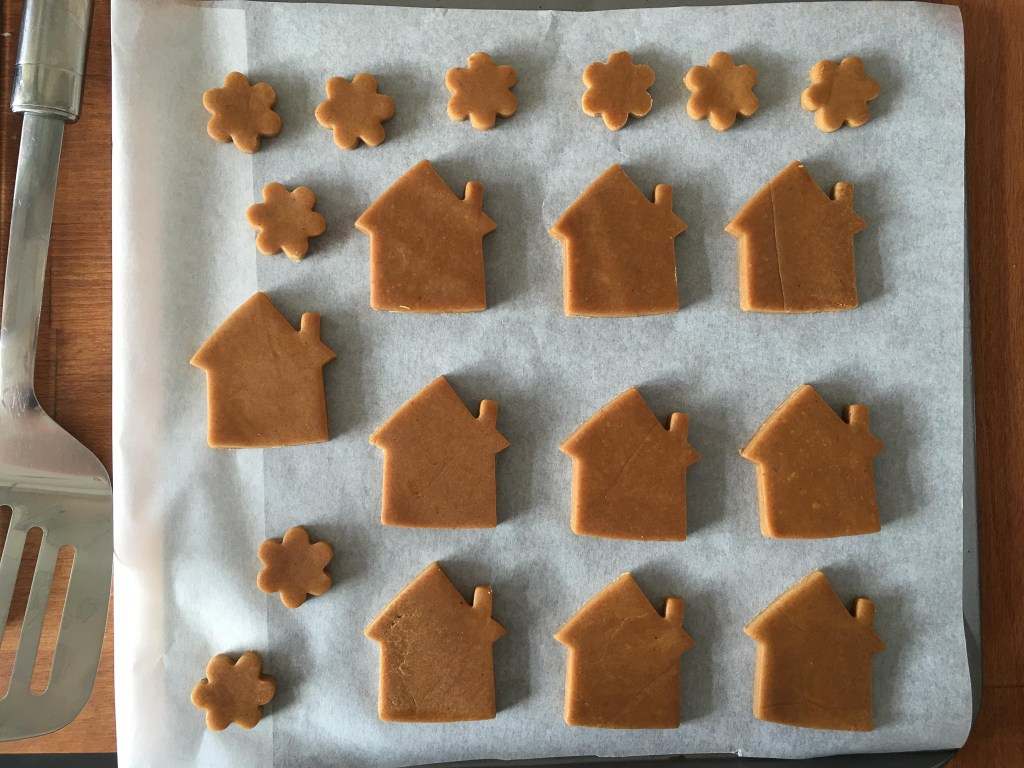 gingerbread house cookies on a baking tray