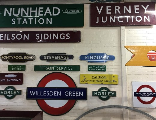 wall of vintage signs at Buckinghamshire Railway Centre