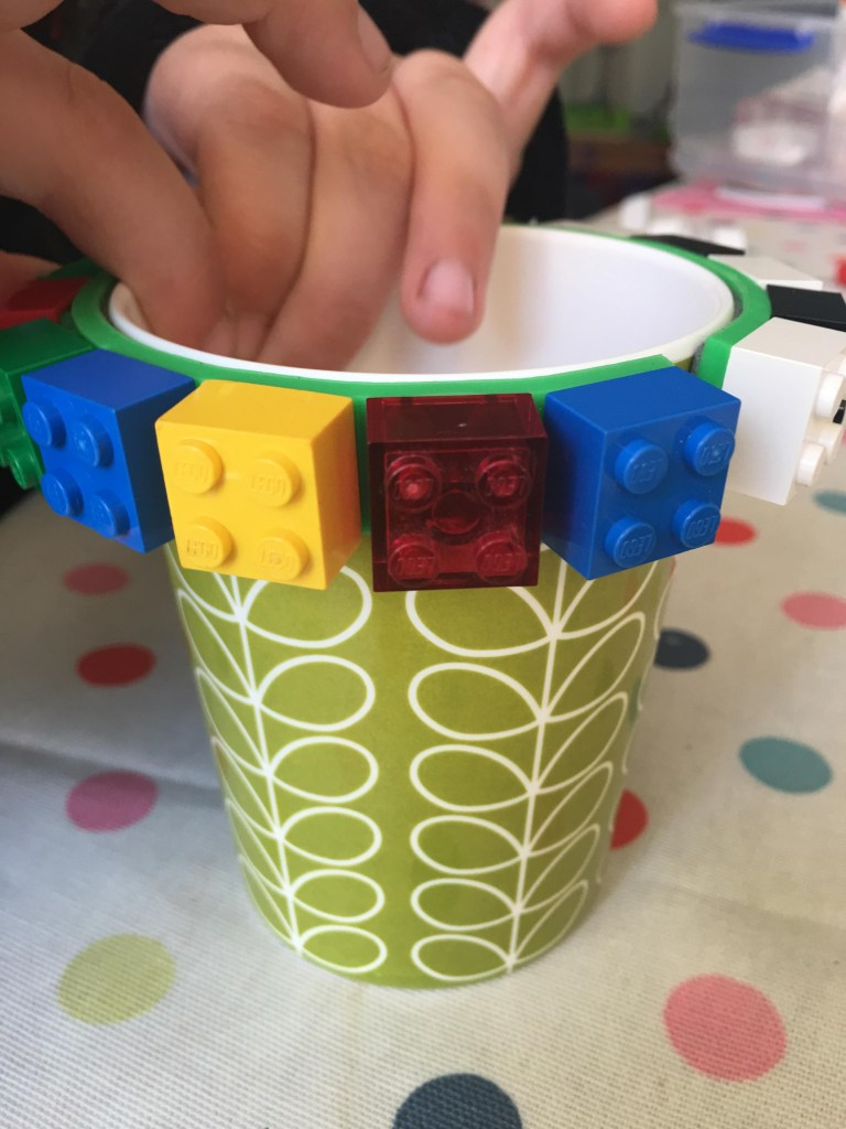 lego tape around a cup