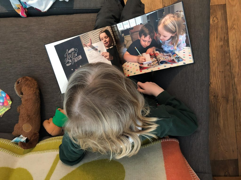 child looking through a photo book