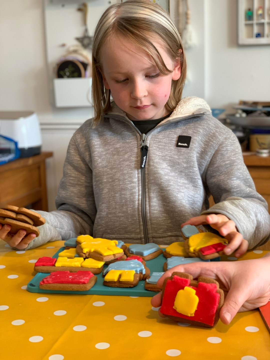 girl with brightly iced Lego biscuits