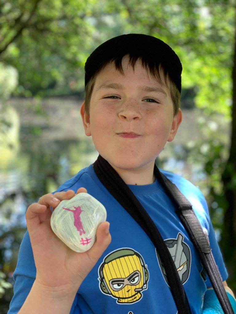 boy holding painted rocks