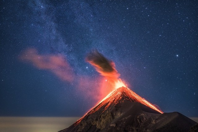 Erupting volcano in front of the Milky Way by Wix photographer Albert Dros