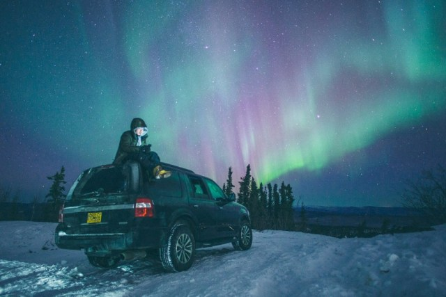 Green lights in winter with car by Wix photographer Nikk La
