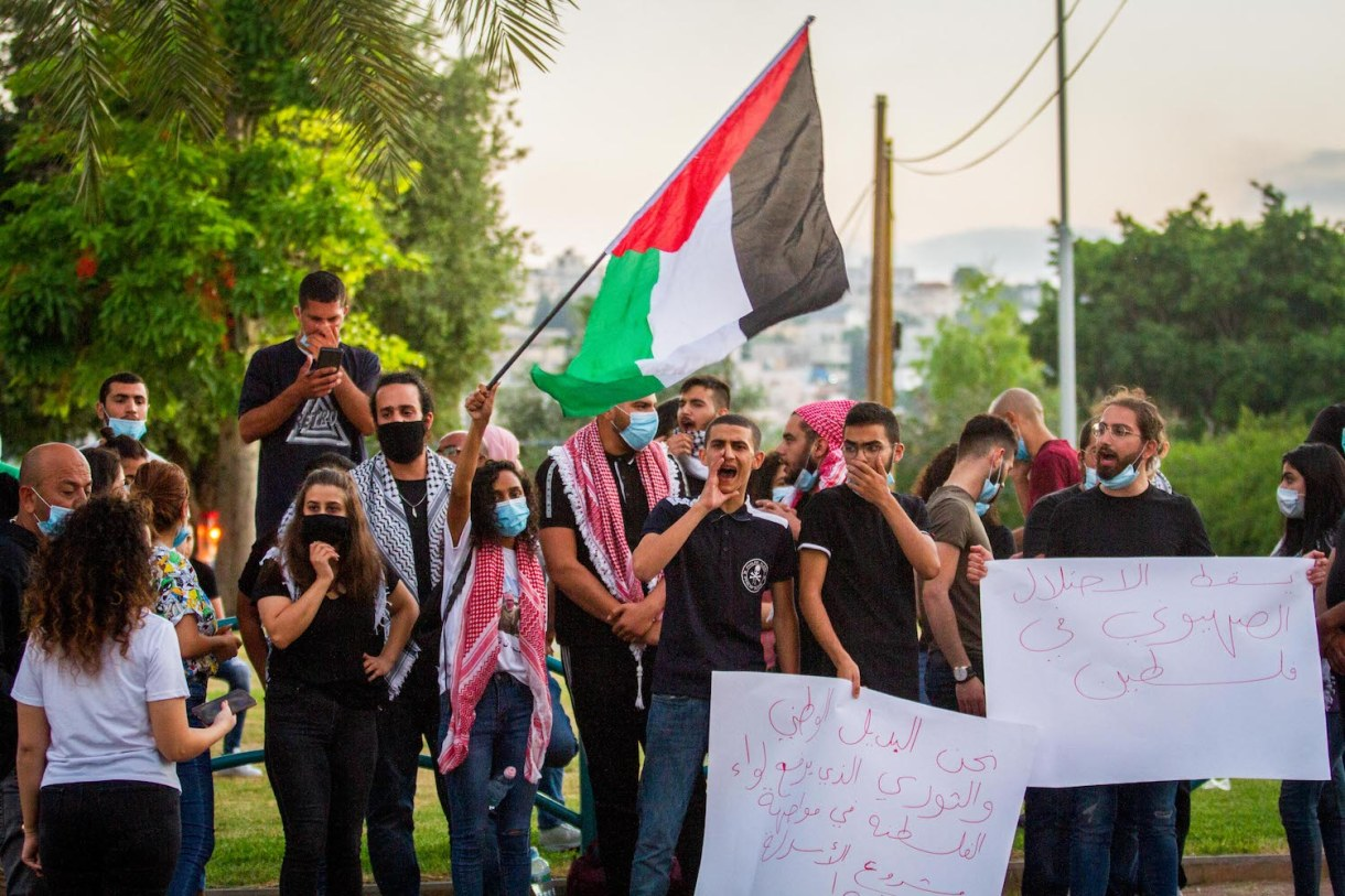 Palestinian citizens protest against Israel's plan to annex parts of the West Bank, near the town of Ar'ara, July 1, 2020. (Flash90)