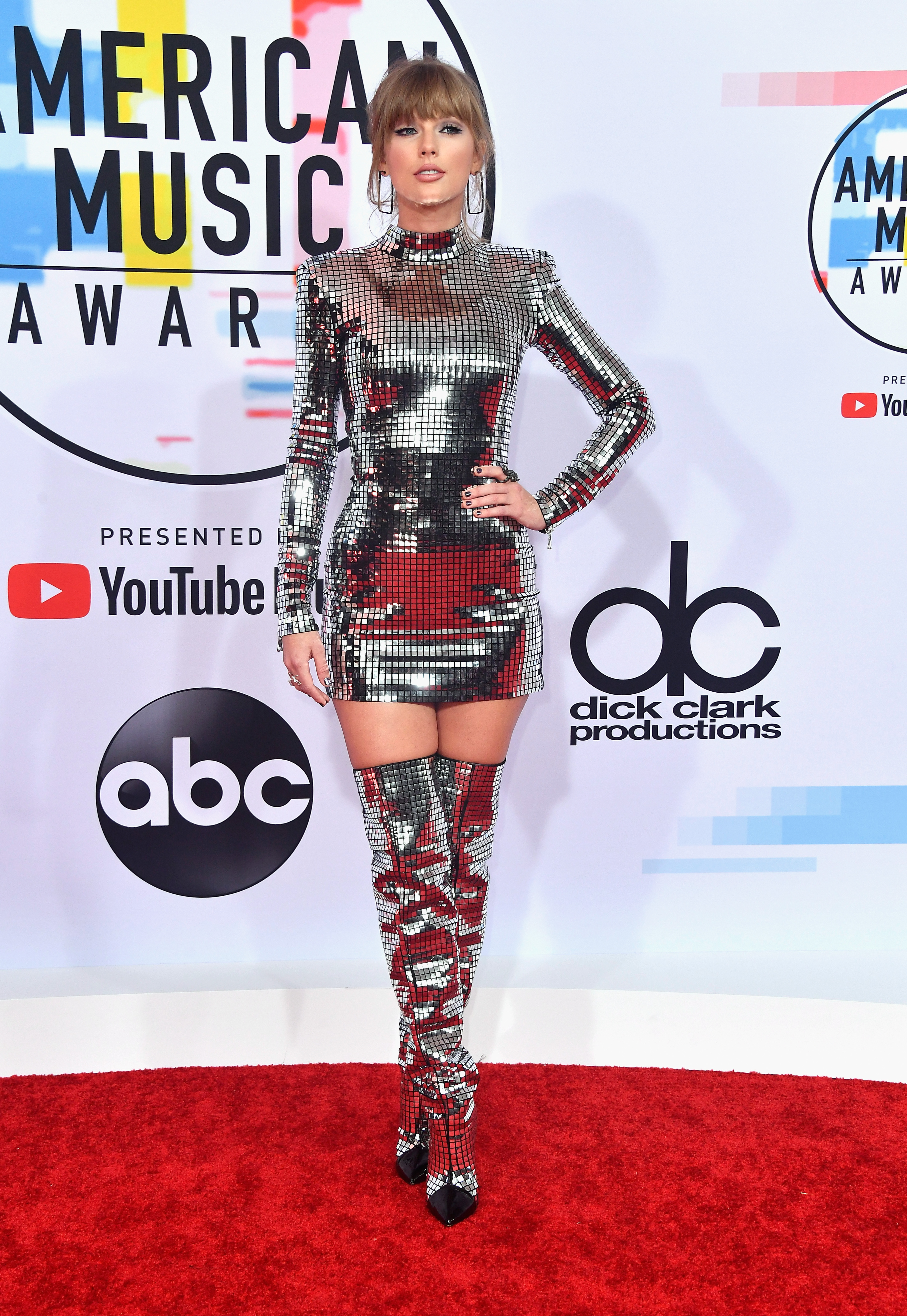 Taylor Swift Goes Metallic In Thigh High Boots And