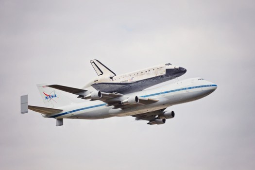 Discovery is ferried to Washington-Dulles Airport via NASA 905, the Shuttle Carrier Aircraft.  After de-mating, ownership of the shuttle was formally transferred to the Smithsonian's National Air & Space Museum.