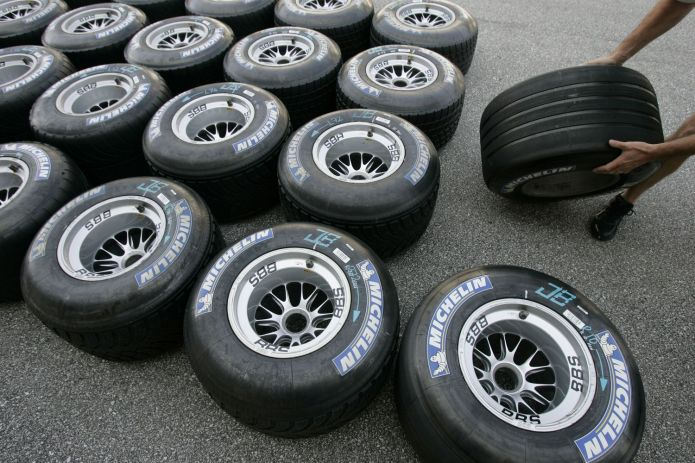 Michelin Formula One tyres are prepared for racing in the pits at the Indianapolis Motor Speedway in 2006. (Reuters photo)
