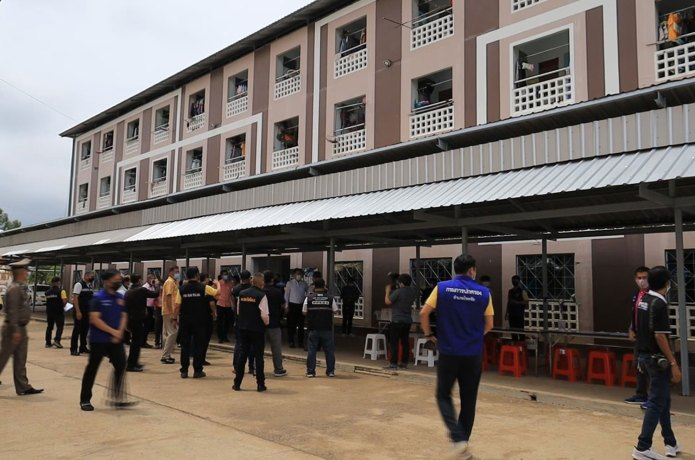 Officials inspect a workers' dormitory one of the two big chicken processing plants sealed off in Chock Chai district, Nakhon Ratchasima, on Friday. More than 100 workers have been confirmed infected with Covid-19 and testing is continuing. (Photo: Prasit Tangprasert)